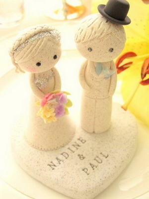 Handmade stone carved cake topper